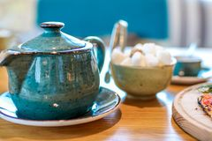Tea set on wooden table royalty free stock image