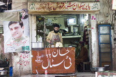 Tea shop and electoral campaign posters. Tea shop and vendor at the Anarkali bazaar with electoral campaign posters of Hamza Shahbaz Sharif and Nawaz Sharif Stock Images