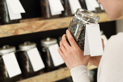 Tea shop. Woman chooses a drink while shopping in a store tea Royalty Free Stock Photo