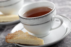 Tea and shortbread. Cup of black tea and the slice of shortbread Royalty Free Stock Images