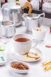 Tea and shortbread biscuit Stock Photo
