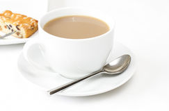 Tea with a slice of fruit cake Stock Image