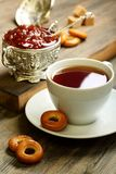 Tea with small bagels and fig jam. Royalty Free Stock Image