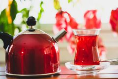 Tea in small cup on table royalty free stock photography