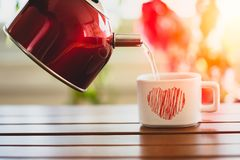 Tea in small cup on table stock photography