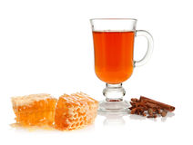 Tea, spice and honey. Hot tea in glass cup with spice and honey on white background Stock Images
