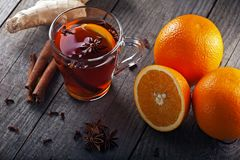 Tea with spices and oranges Stock Photography