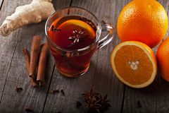 Tea with spices and oranges Royalty Free Stock Images