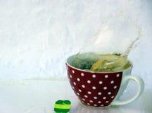 Tea splash fun Royalty Free Stock Photography