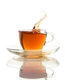 Tea splash in a glass cup Royalty Free Stock Photos
