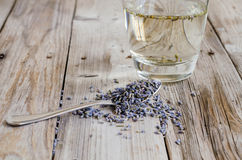 A tea spoon of dried lavender on wood table Stock Images