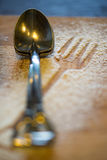 Tea spoon on wooden plate with icing sugar powder formed as folk Royalty Free Stock Photo
