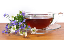 Tea and spring flowers Royalty Free Stock Image