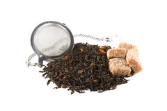 Tea-stainer with tea and brown sugar Stock Images