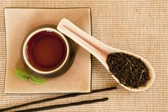 Tea still life. Black tea still life with incense sticks and mint leave Stock Photo