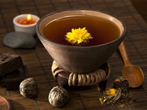 Tea still life. Organic tea with chrysanthemum flower Royalty Free Stock Images