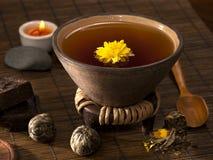 Tea still life. Organic tea with chrysanthemum flower royalty free stock images