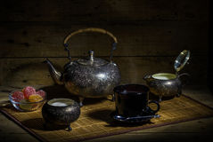 Tea. Still Life with Indian tea, sweets, sugar and milk Royalty Free Stock Images