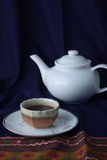 Tea still life on blue draped cloth Royalty Free Stock Images