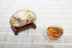 Tea and stone Royalty Free Stock Images