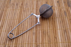 Tea strainer. On wooden bamboo background Royalty Free Stock Image