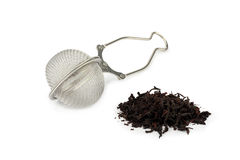 Tea-strainer and black tea. Isolated on white background Stock Photo