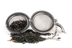 Tea strainer on a chain isolated white background Stock Photography