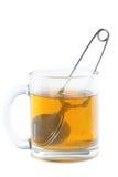 Tea strainer in cup Stock Image