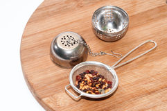 Tea strainer with dog rose tea Royalty Free Stock Image