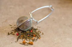 Tea strainer with exotic tea Stock Photo