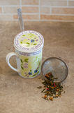 Tea strainer with exotic tea Stock Photography