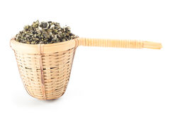 Tea strainer with green tea. On white background Stock Images
