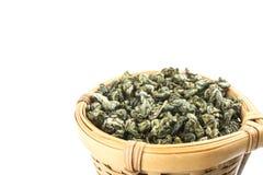 Tea strainer with green tea. On white Royalty Free Stock Photo