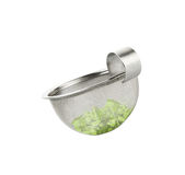 Tea strainer loaded with green tea Royalty Free Stock Photography