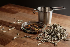 Tea strainer and loose tea Royalty Free Stock Images