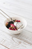 Tea strainer and rose buds Stock Image