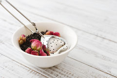 Tea strainer and rose buds Stock Photography