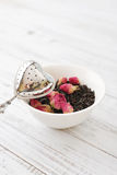Tea strainer and rose buds Royalty Free Stock Photo