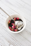 Tea strainer and rose buds Royalty Free Stock Image