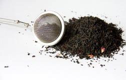 Tea Strainer and Tea. Tea Strainer and Black Tea Stock Photo