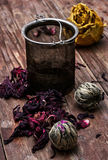 Tea strainer and tea leaves Royalty Free Stock Photos