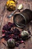 Tea strainer and tea leaves Stock Photos