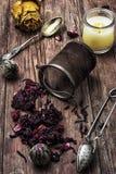 Tea strainer and tea leaves Stock Photo