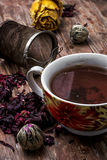 Tea strainer and tea leaves Stock Images