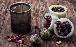 Tea strainer and tea leaves Royalty Free Stock Images