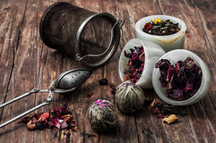 Tea strainer and tea leaves Stock Photography