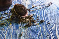 Tea strainer tea leaves on the table. Stock Photography