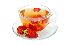 Tea with strawberries in a glass cup Royalty Free Stock Photography