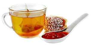 Tea with strawberry jam and biscuits Stock Images