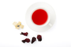 Tea from Sudanese rose. Sugar, dried Sudanese rose isolated on a white background Stock Photos